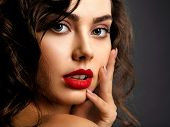 Closeup Face of a beautiful woman with a smoky eye makeup and red lipstick. Sexy and gorgeous brunet poster