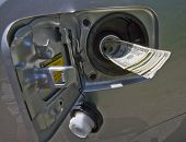 picture of high-octane  - Concept image with gas nozzle emerging money - JPG