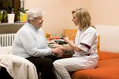 pic of health-care  - A home visit Nurse with senior Woman - JPG