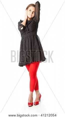 Portrait of teen girl. The girl is wearing black dress and red tights. Isolated on white background
