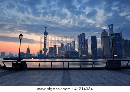 Shanghai morning before sunrise with city skyline and colorful sky over Huangpu River