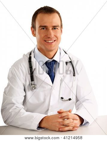 A portrait of a doctor sitting at the desk on white background