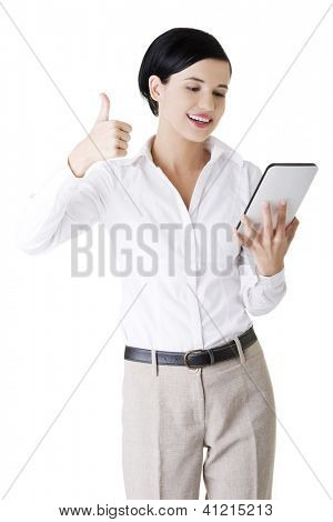 Business woman holding tablet computer with touchpad and gesturing OK. Isolated on white.