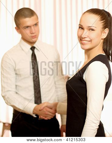 Photo of partners handshaking