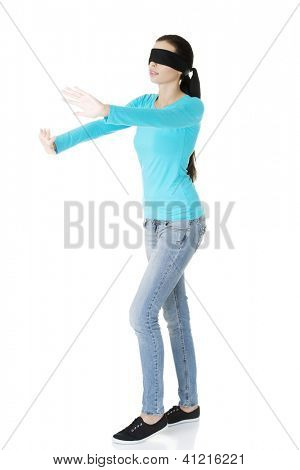 Portrait of the young blindfold woman using senses, isolated on white