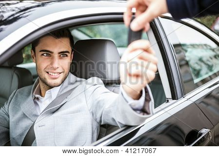 Man taking car key