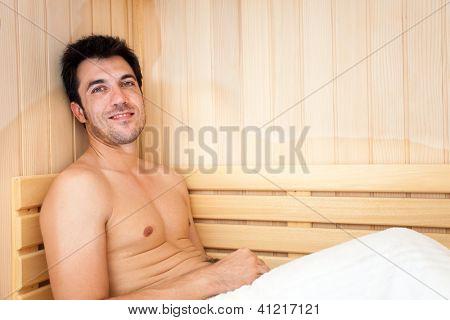 Handsome man having a steam bath in a sauna