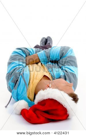 Laying Man With Christmas Hat And Canal Phones