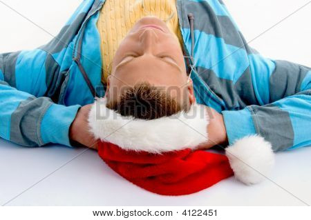 Portrait Of Laying Man With Christmas Hat