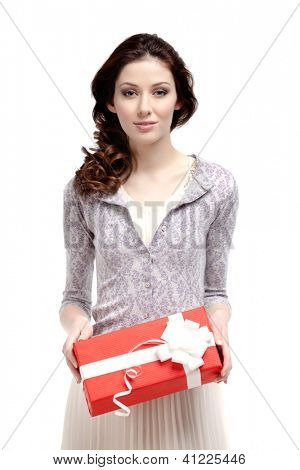 Young woman has a xmas gift wrapped in red paper, isolated on white