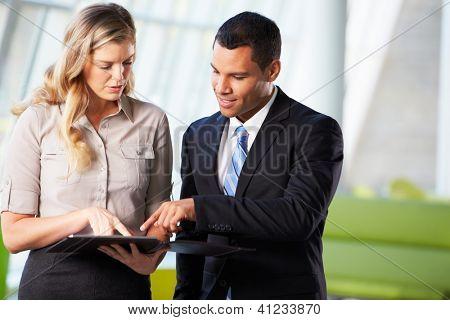 Businessman And Businesswomen Having Informal Meeting In Office