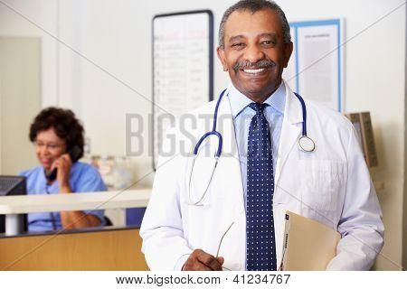 Portrait Of Doctor At Nurses Station