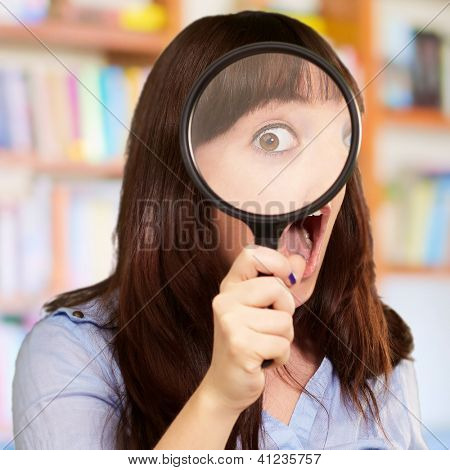Woman Holding Magnifying Glass, Indoor