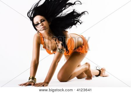 Young Female In Orange Flicking Long Hair