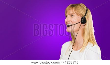 Happy Woman On Headset against a purple background