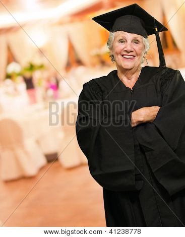Senior Graduate Woman With Hands Folded, Indoors