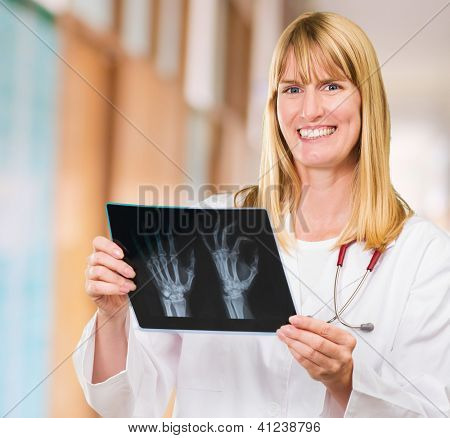 Portrait Of Happy Doctor Holding X-ray, indoor