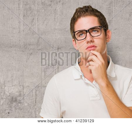 Young Man Wondering against a grunge background