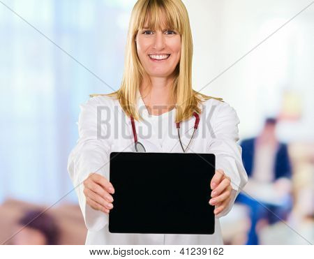 Happy Doctor Showing Digital Tablet in a waiting area