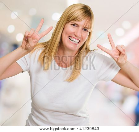 Happy Woman Showing Peace Sign, indoor