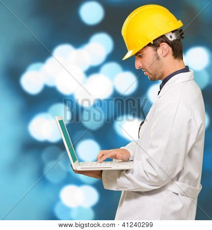 Architect Working On Laptop, Outdoors
