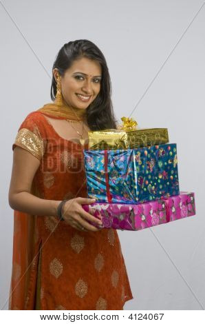 A  Happy Lady With Gifts For New Year