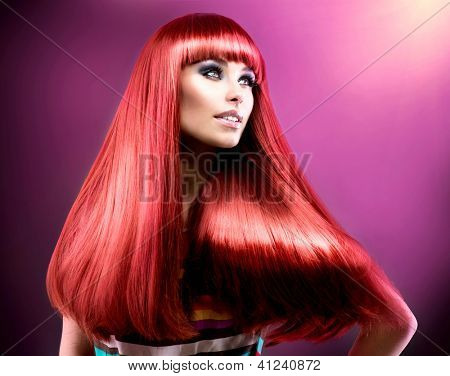 Hair. Healthy Straight Long Red Hair. Fashion Beauty Model over Purple Background. Vogue Style. Beautiful Glamour Woman Portrait