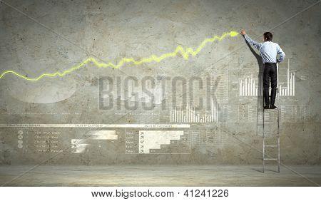 businessman drawing diagram