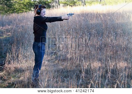 Woman Shooting A Firearm