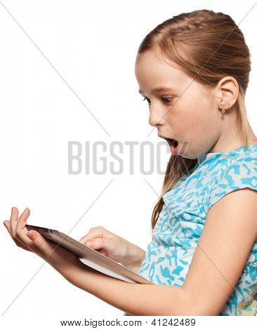 Surprised child looks to the tablet computer. Kid with tablet isolated on white background