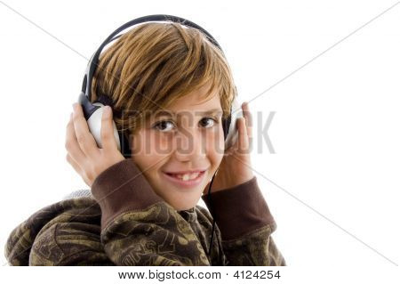 Portrait Of Smiling Child Enjoying Music