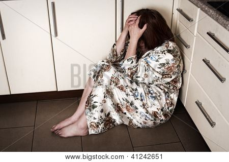 Adult woman crying sitting on the floor. Hopelessness, depressions, sadness, stress, grief, loneliness, problems.