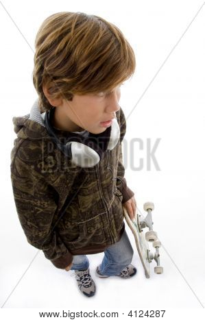 Top View Of Child With Skate And Headphone