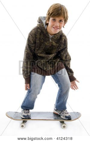 Child Standing On Skateboard