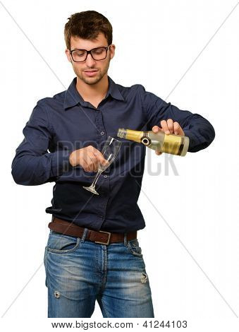 Young Man Pouring Champagne Into Glass Isolated On White Background