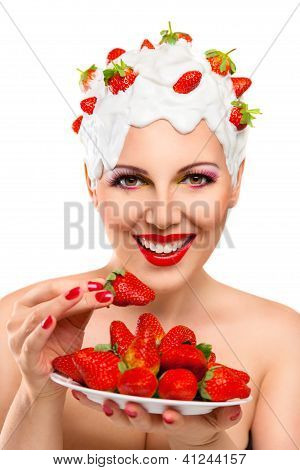 Young Woman Eating Red Ripe Strawberry