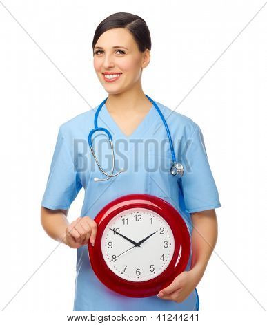 Young doctor with clock isolated