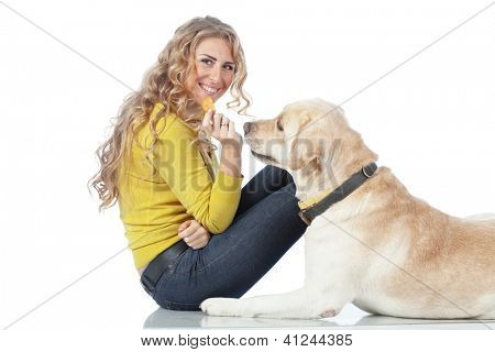 Portrait of happy girl with her dog isolated on white background