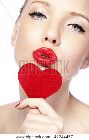 Beautiful gorgeous woman with glamour bright makeup and red heart