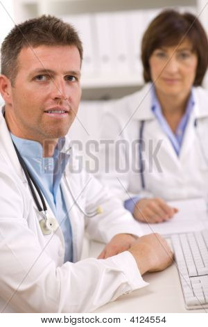 Doctors Working At Office