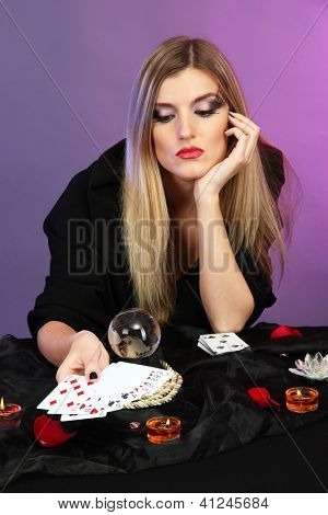 Witch - fortune teller on color background