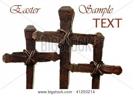 Macro images of rusty nail crosses on white background with copy space.