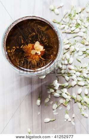 Flowering Tea and Dry Flowers on Wooden Background