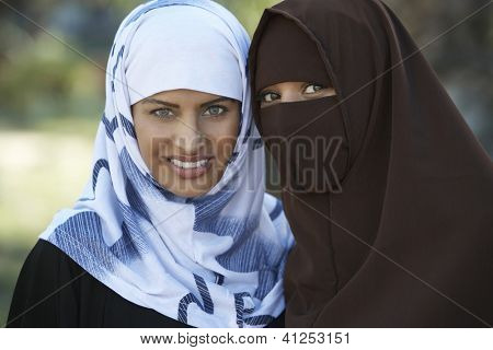 Portrait of two Muslim female friends in traditional clothes