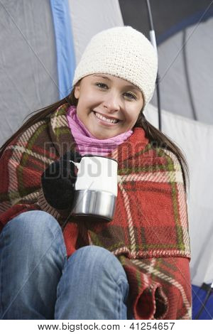 Portrait of a happy young female with coffee cup while campaign