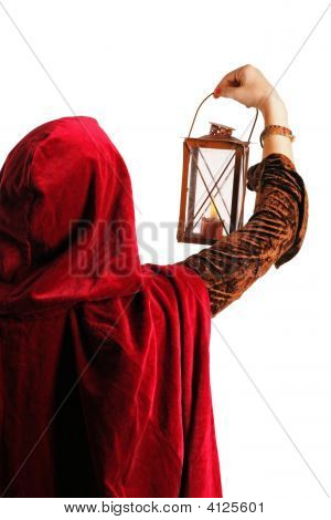 Girl In Red Cloak With A Lantern