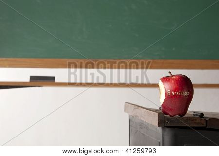 Apple in front of blackboard