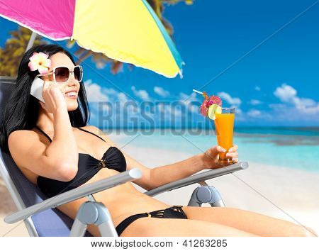 Woman On The Beach Calling By Mobile Phone