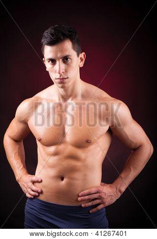 Image of a handsome athletic man on black background
