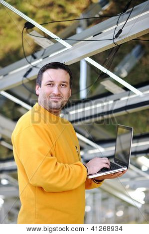 Engineer using laptop at factory
